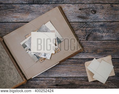 Clear Blank Photo Frames To Placed Your Pictures Or Text On Old Family Album On Wooden Board Backgro