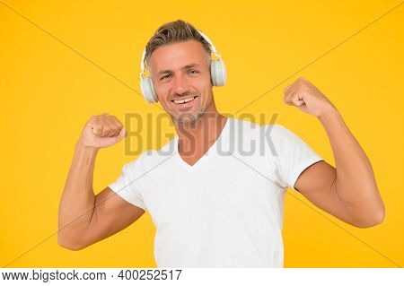 Musical Strength Workout. Fit Melomane Flex Arms Listening To Music. Sound Technology. Stereo Headph