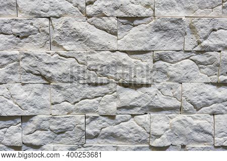 Seamless Texture Of White Decorative Stacked Stone, Natural Stone Cladding. Brick Background. Close