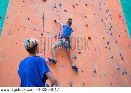A Boy Climbs The Wall, A Coach Teaches A Child