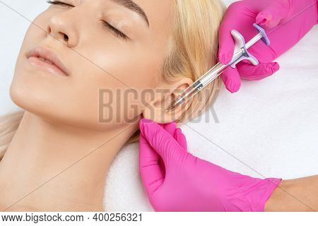 The Doctor Does Injections To Correct The Hump On The Nose With The Beauty Of The Blonde. The Beauti