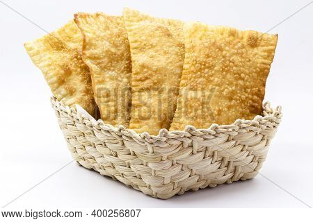 Brazilian Pastry, Traditional Pastry Called Fried Meat Pastry, In Straw Basket, Isolated On White Ba