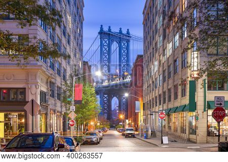 Brooklyn, New York, USA street scene at the Brooklyn Bridge during twilight.