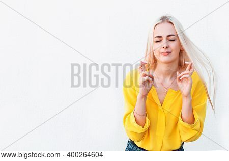 Woman Holding Fingers Crossed Isolated On White Background