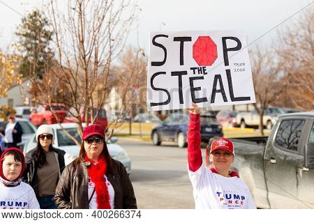 Helena, Montana - Nov 7, 2020: Woman Protesting At Stop The Steal Rally Holding Sign, Wearing Trump