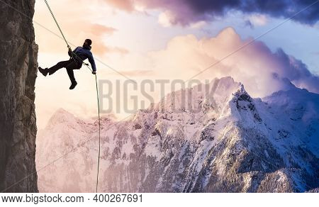Epic Adventurous Extreme Sport Composite Of Rock Climbing Man Rappelling From A Cliff. Mountain Land