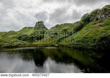 The Small Pond And Reflected Rocks Of Faerie Castle (castle Ewen) At The Fairy Glen In Isle Of Skye