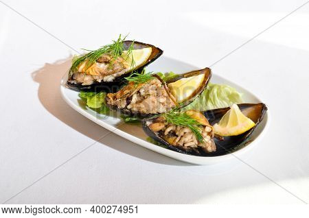 Midye Dolma, Stuffed Mussels Turkish Food With A Beautiful Presentation, In A White Plate