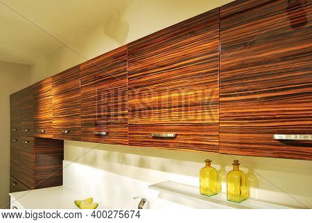 Interior Of Luxurious Modern Kitchen Equipment, White And Ebony Cabinets