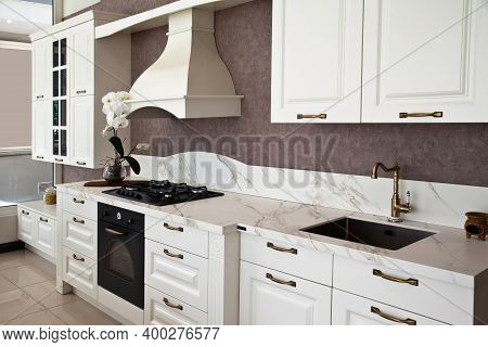 Interior Of Luxurious Modern Kitchen And White Cabinets
