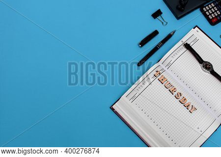Modern Office Desk Workplace With Blank Notebook, Pen And Supplies. Copy Space On Blue Background. T