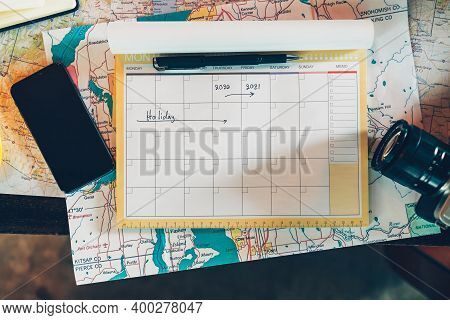 Tourist Hold Pen And Planning Vacation With Calendar And Map. Travel, Holiday, Vocation And New Year
