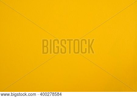 Yellow Cement Or Concrete Wall Texture For Background. High Resolution Through Retouching Process Pa