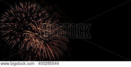 Holiday Fireworks At New Year Eve. Abstract Festive Background With Fireworks Sparkles. Copyspace