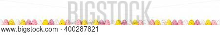 Amazing Easter Border With Small Colourful Eggs Isolated On White. Panorama Paint Eggs. Yellow, Pink