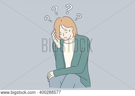 Sadness, Mental Depression, Doubt Concept. Young Unhappy Woman Sitting Touching Head And Feeling Dep