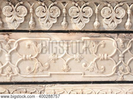 Detail of ancient floral bas-relief on marble. Ancient carving with flower ornament on marble in Taj Mahal, India