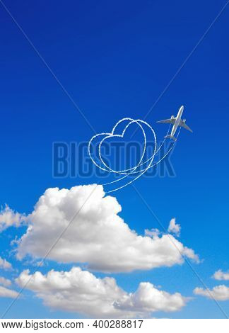 Aircraft draw a heart in the sky. Flight route of aircraft in shape of a heart. Love concept for traveling the world