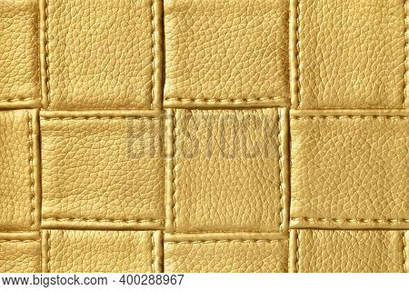 Texture Of Dark Golden And Yellow Leather Background With Square Pattern And Stitch, Macro. Abstract