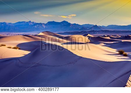 Mesquite Flat Sand Dunes - dunes in Death Valley, USA. Easily accessible dunes are located along Road 190. Magical desert morning. The concept of active, extreme and photo tourism