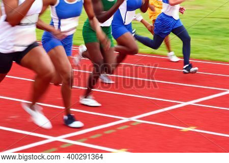 Out of focus Motion blurred image of women in a track and field sprint event