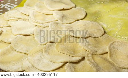 The Process Of Cooking Dumplings. The Process Of Making Dough For Dumplings, Rolling Out The Dough A