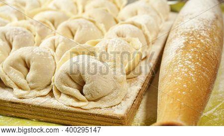 Meat Russian Dumplings On A Cutting Board . The Method Of Cooking The Dumplings. Russian Dumplings W
