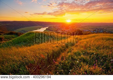 Awesome colorfull cloudscape over the Dniester river. Vivid clouds illuminated by the beams of the sun. Location place Dnister canyon of Ukraine, Europe. Photo wallpaper. Discover the beauty of earth.