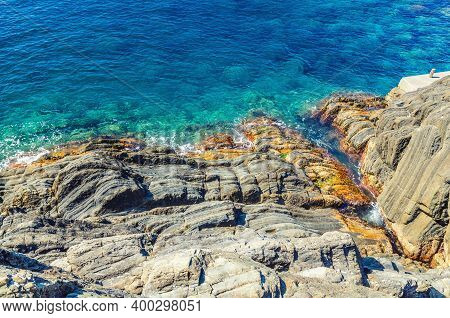 Rocks And Cliffs Coastline Of Water Of Ligurian And Mediterranean Sea, Top View