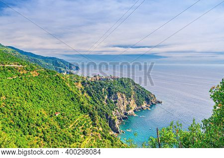 Aerial Panoramic View Of Corniglia Typical Italian Village With Colorful Buildings On Rock Cliff, Ge