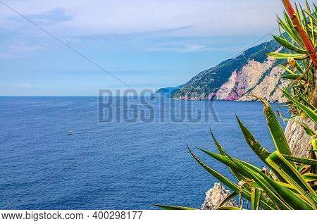 Grotta Di Lord Byron With Blue Water, Coast With Rock Cliff, Yellow Boat And Blue Sky Near Portovene