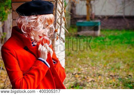 Happy French Woman. Portrait Of Young Blonde Woman In Beret Smiling In French Vintage Style. Retro S