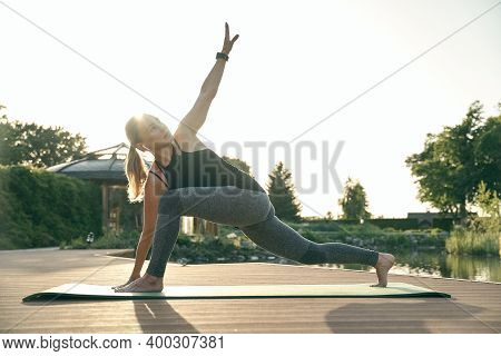 Retain Beauty Of Your Body. Full Length Shot Of Sporty Woman Stretching Her Body, Standing In Extend