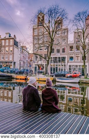 Amsterdam Dutch Canals , Couple Visit Dutch Canals During City Trip In Amsterdam, Men And Woman On C