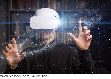 Man Uses Virtual Reality Glasses To See The Galaxy Space. Elements Of This Image Furnished By Nasa.