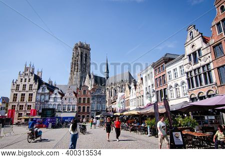 Mechelen, Belgium, August 2019. The Big Square: The Grote Markt. The Bell Tower Of The Cathedral Sta