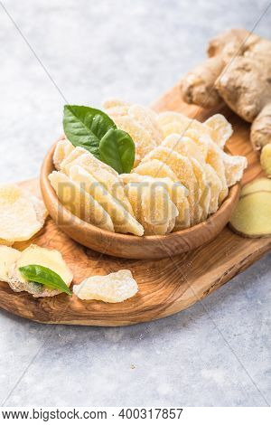 Slices Of Ginger Dried Fruit  And Ginger Root On A Stone Table. Against Viruses And Diseases. Immune