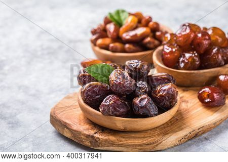 Dates Or Dattes Palm Fruit In Wooden Bowl Is Snack Healthy. Dates Palm Fruit Isolated On White. Drie