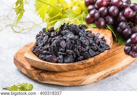 Black Raisins  In Bowl On Stone  Background, Table Top View. Dried Fruit, Healthy Snack Food. Dry Bl