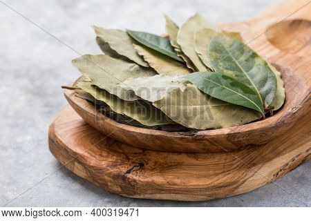 Bay Leaf Or Laurel (laurus Nobilis), Sliced Garlic & Garlic Clove On Wooden Background. Bay Leaf Or
