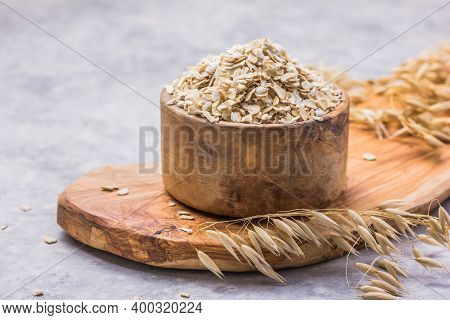 Oat. Oat Flakes. Dry Oat Flakes, Oatmeal On A Wooden Background. Healthy Vegan, Vegetarian Food. Cle