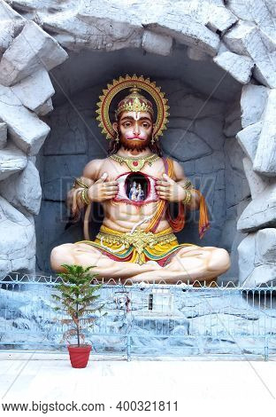 Ancient Statue Of Hindu God Hanuman In Rishikesh On The Ghat Near Parmarth Niketan Ashram. India.