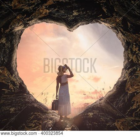 International Human Rights Day Concept: Silhouette Alone Woman Standing On Cave Of Heart And Meadow