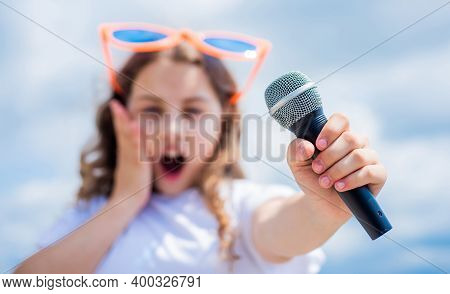 Kid Sing With Mic. Selective Focus. Cheerful Event Manager. Child Have Fun On Party. Happy Singer Wi