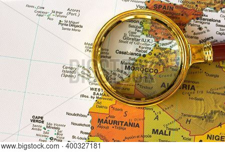 Lviv Ukraine-25 11 2020: Morocco, Gibraltar On The Map Of North Africa A Defocused Magnifying Glass,