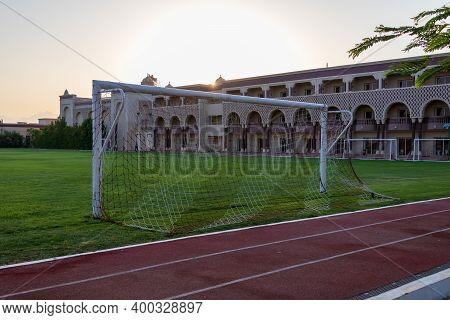 Hurghada, Egypt - September 24 2020: Soccer Football Field At Sunset With Palm Trees In Egypt.