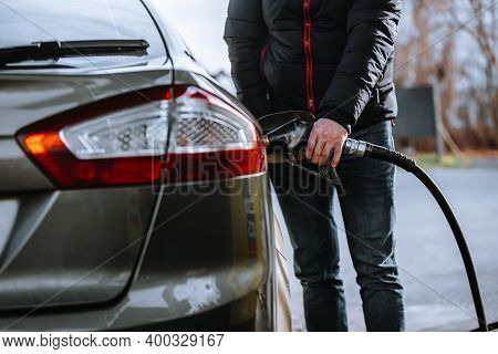 Man Refueling A Car In The Gas Station, Refuel The Car