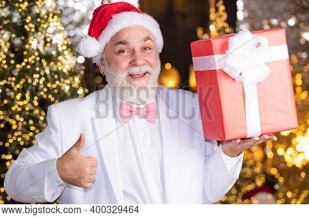 Bearded Grandfather Man Celebrate Christmas. Christmas Party. Senior Man With Beard. Christmas Gift.