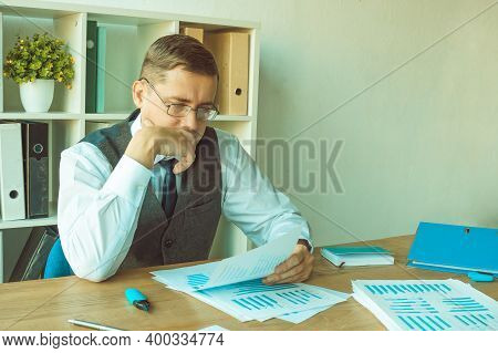 Internal Financial Audit. The Auditor Examines Documents And Reports. Paper Work.
