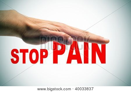 a man hand above the sentence stop pain written in red